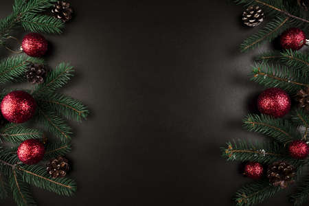 christmas composition of green fir tree branches with red baubles. Resolution and high quality beautiful photo