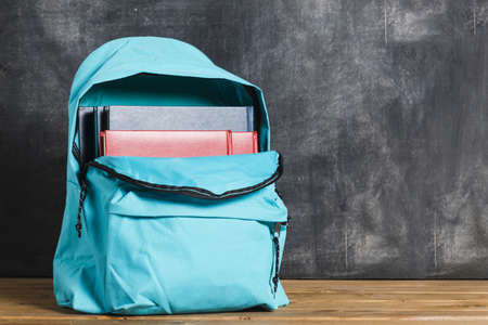 blue backpack with textbooks. Resolution and high quality beautiful photo