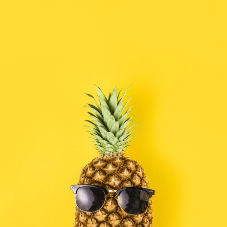 bright pineapple sunglasses. Resolution and high quality beautiful photo Banco de Imagens