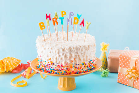 birthday cake with gift accessories blue background. Resolution and high quality beautiful photo