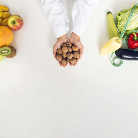 close up person with vegetables holding nuts. Resolution and high quality beautiful photo