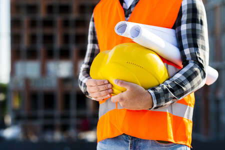 close up construction engineer holding helmet. Resolution and high quality beautiful photo