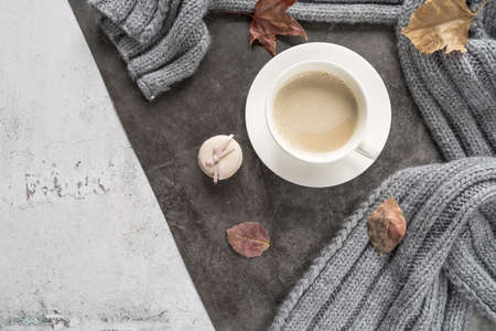 coffee with milk warm sweater shabby surface. Resolution and high quality beautiful photo Banco de Imagens