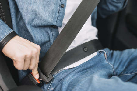 close up man putting safety belt. Resolution and high quality beautiful photo