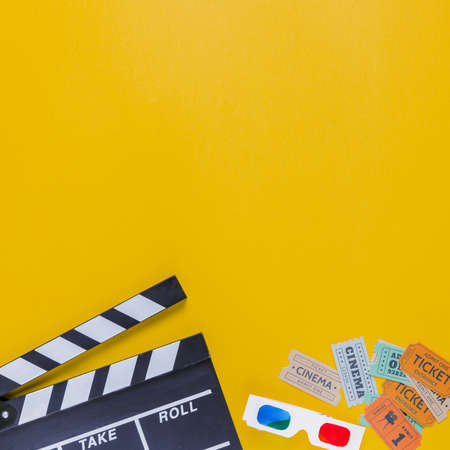 clapperboard with cinema tickets 3d glasses. Resolution and high quality beautiful photo Banco de Imagens