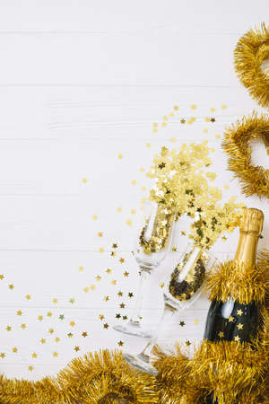 champagne bottle with tinsel table. Resolution and high quality beautiful photo Banco de Imagens