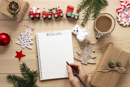 christmas list mock up wooden background. Resolution and high quality beautiful photo Banco de Imagens