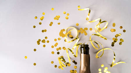 champagne bottle with golden confetti streamers white background. Resolution and high quality beautiful photo