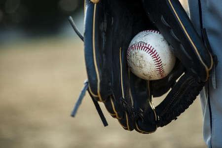 close up baseball held glove. Resolution and high quality beautiful photo Banco de Imagens