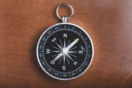 close up of compass on wooden background. Resolution and high quality beautiful photo Stockfoto