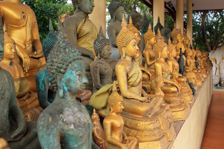 oldish: Ancient Buddha Statues - Row of different kind of Thailand old Buddha statues Stock Photo