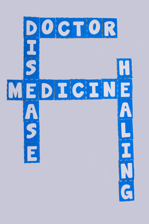 healt: Text medicine , treat , inscribed in white uppercase letters and arranged crossword style to mean medicine treat the disease with the doctors help for the pacients healt , white background. Stock Photo
