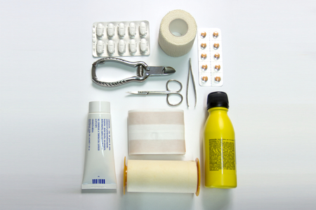 Top view of objects for a first aid kit box with medical equipment and medications for emergency.