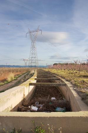 Irrigation channel full of bottles of plastic