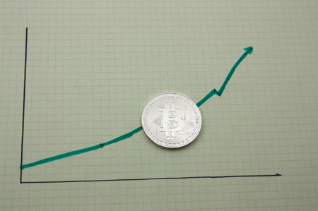 A green colored graphic that indicates the rise of bitcoin profits Standard-Bild - 119624703