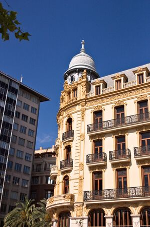 Image from the street of the Ernesto Ferrer Building located in the Plaza del Ayuntamiento in Valencia, Spain. It was built between 1910 and 1912 by Francisco Almenar Quinz