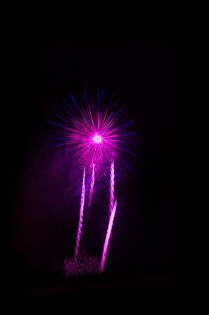 Several shots of a purple colored fireworks castle isolated over the black night skye