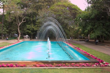 Water fountain with multiple sparkling water jets that make different figures