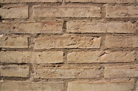 Close-up of an old light brown brick wall for abstract backgrounds