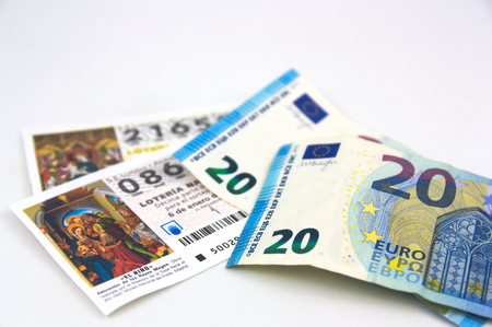 2019. Spain. Some euro bills on some tickets for the draw for the national Christmas lottery.
