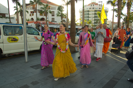 January 2018. Las Américas, Arona, SC Tenerife, Spain. A group of Hare Krishna dancing through the streets of Las Américas beach in Arona. Редакционное