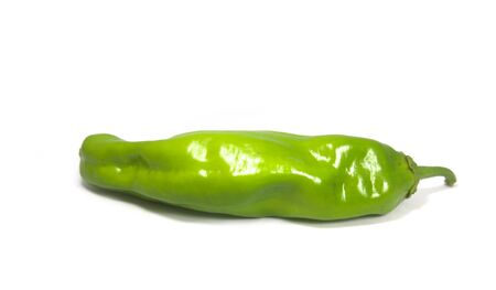 An elongated Italian pepper isolated on a white background for clipping, copy space