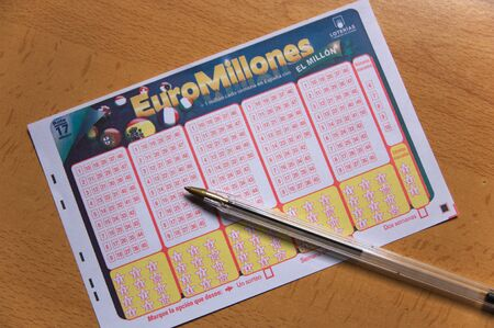 December 2019. Spain. Euromillions ticket from the Spanish national lottery next to a pen ready to be filled