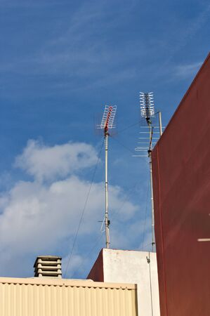 Community television antennas in some buildings where several neighbors live. In the image there is space for texts or graphics, copy space Zdjęcie Seryjne