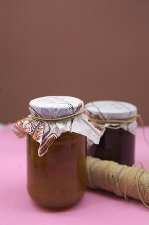 Close-up of two homemade jam jars with space in the background for text space
