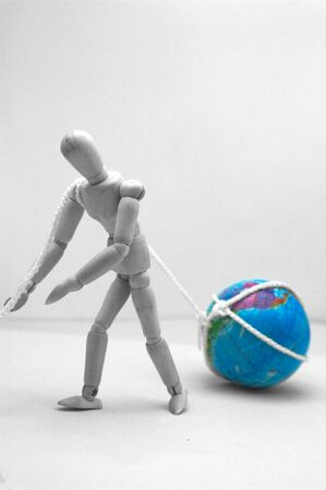 A dummy sweeps the world. Conceptual image that refers to the exhaustion of carrying a lot of emotional or labor burden to which this world is subject to us Stok Fotoğraf