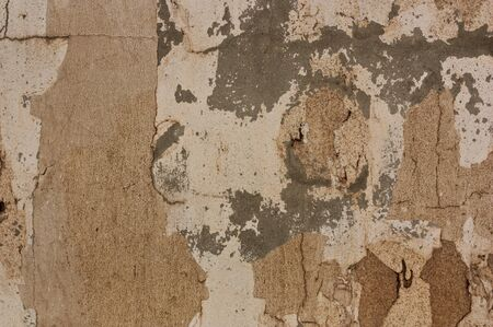 Texture of a wall to which the passage of time has caused the paint to fall giving rise to a background of different colors and textures that gives it a grunge touch
