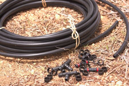 Image of a drip irrigation rubber with some useful accessories for the installation of this irrigation system