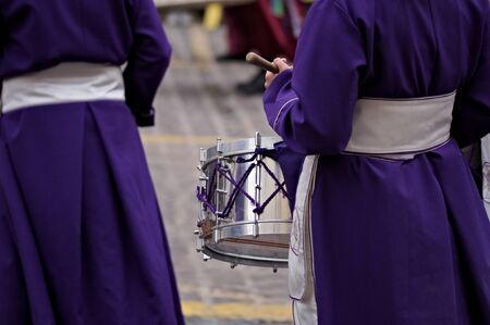 Image of some brothers carrying drums to make a procession during Easter