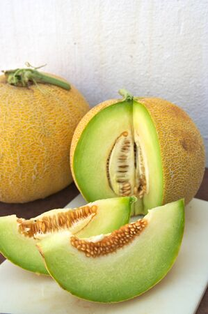 Two slices of cantaloupe melon (Cucumis melo cantalupensis) together with two pieces of this type of melon