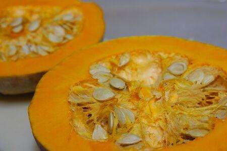 Close-up of an open pumpkin showing the detail of natural pumpkin seeds Stok Fotoğraf