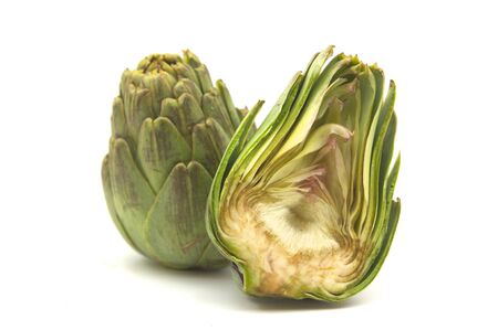 Close-up of some artichokes cut in half and isolated on a white background Stockfoto