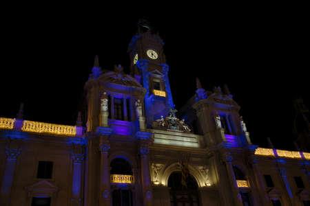 December, 2019. Valencia, Spain. Facade of the City Hall of the city of Valencia with the typical Christmas lighting Stock Photo