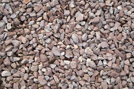 A closeup of gravel and pebbles used to avoid puddles on the sandy soils occupy the image