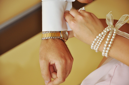 get dressed: Bride helping groom with his cufflinks