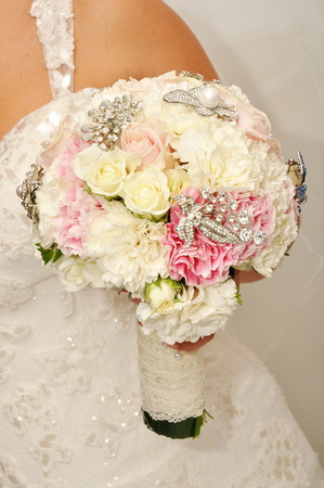 honeymooners: Beautiful wedding dress and bouquet Stock Photo