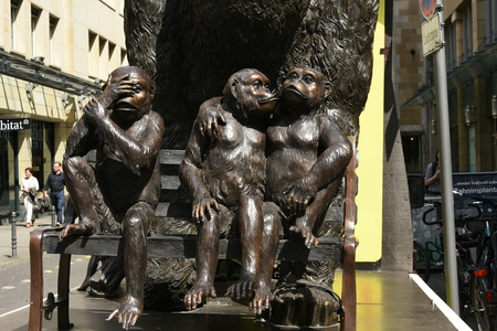may, 2017,Three Monkeys Sitting on Bench Sculpture Bronze in Koln,Cologne, Germany,