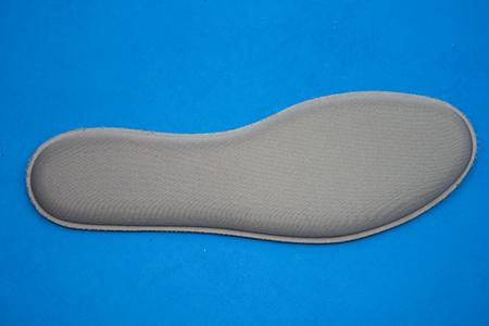 gray Memory Foam Shoe Insoles on blue background