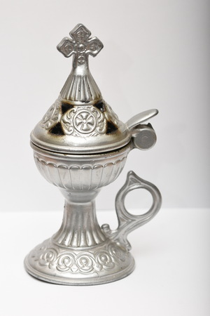 bronze Incense burner with a cross on white background
