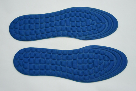 Blue Shoe Insoles on blue background
