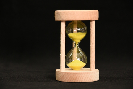 hourglass with yellow  sand Stock Photo