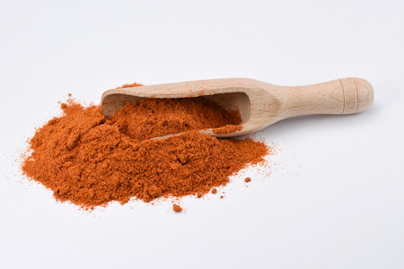 Paprika powder isolated white background