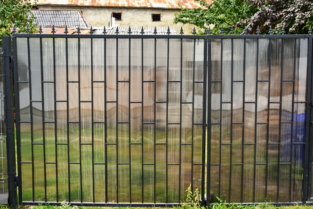 Forged decorative fence for garden and building.