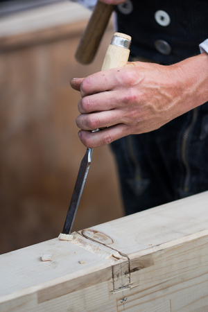 carpenter hands working with a chisel,detail