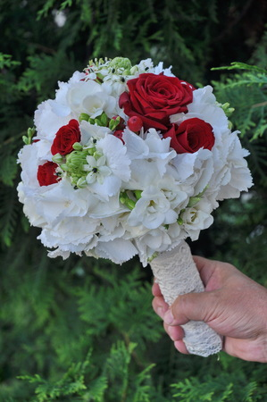 groom holding bride bouquet Stock Photo