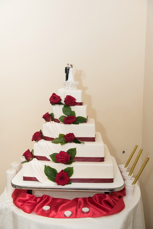 White wedding cake decorated with sugar flowers Stock Photo